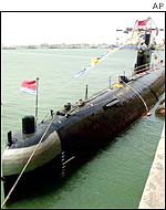 A Chinese Navy submarine docks at a Navy base in Qingdao, China