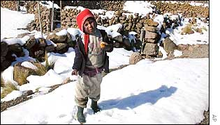 Peruvian child amidst the snow