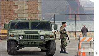 A National Guardsman stands at the ready under the Golden Gate Bridge