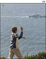 Moroccan child aims slingshot at Spanish warship patrolling near Perejil island