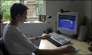 Teenager using computer