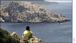 Moroccan child looks out to the island of Perejil