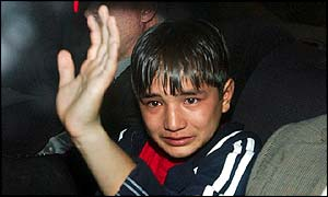 A tearful boy after he failed to get asylum in Britain