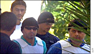 Christodoulos Xiros (R) and Vasilis Xiros(L top) arrested on suspicion of belonging to November 17.