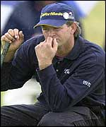 Retief Goosen eyes up a putt on the 13th hole