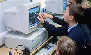 Schoolchildren using a computer