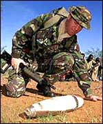 Corporal Phil Johnys inspects an exploded 105mm shell, Samburu district, 2000