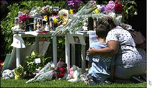 Neighbours pay respects at a memorial to Samantha Runnion in Stanton, California