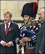 Mr Kennedy, Lord Razzall and a piper