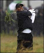 Tiger Woods hacks out of the rough on the 1st hole at Muirfield