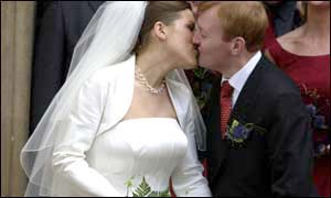 The bride and groom kiss after tying the knot