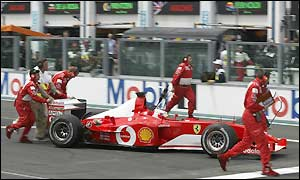 Attempts to restart Rubens Barrichello's car fail and he is withdrawn