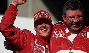 Michael Schumacher celebrates with Ferrari technical director Ross Brawn