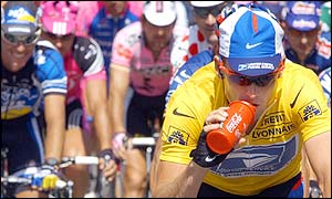 Lance Armstrong takes a drink during the tough climb up Mont Ventoux