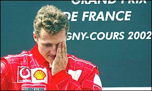 Michael Schumacher on the rostrum after winning his fifth world title