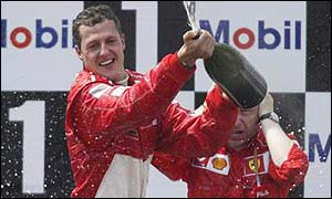 Michael Schumacher on the podium after winning the French Grand Prix