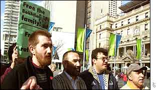 Afghan asylum seeker Ali  Bakhtiyari, second from left, marches with his supporters in Sydney