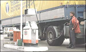 Lorry driver filling up