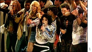 Michael Jackson, centre, is joined by the featured performers of United We Stand: What More Can I Give benefit concert during the finale