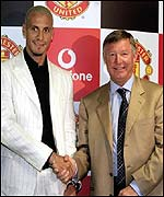 Rio Ferdinand and Sir Alex Ferguson seal the deal with a handshake