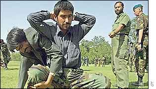 Afghan bodyguards being trained by ISAF instructors