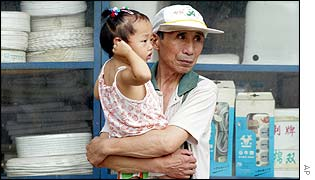 A man holds a young girl in Beijing