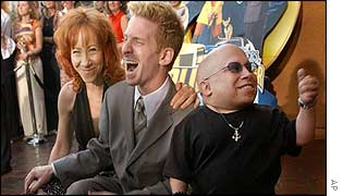 Mindy Sterling, left, with Seth Green and Verne Troyer