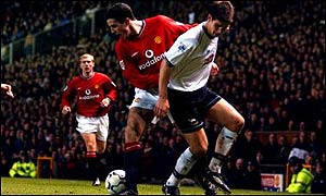 Manchester United's John O'Shea turns inside Derby County's Chris Riggott