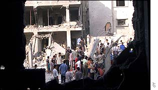 Civilians search the rubble of their houses in Gaza following the attack