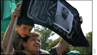 A Palestinian mourner carries a picture of Salah Shehade