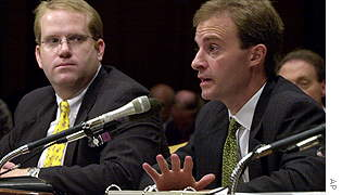 Jeffrey Dellapina, managing director of JPMorgan Chase Bank, testifies before a Senate subcommittee, along with vice president Robert Traband (left).