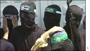 Hooded Hamas members at funerals
