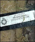 A drainage cover with a police security seal