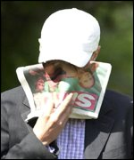 David Norris covers his face as he arrives at court on Wednesday