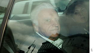 John Rigas, the founder of cable television giant Adelphia Communications, is driven into federal court in Manhattan