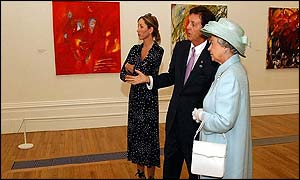 Heather Mills and Sir Paul McCartney showing the Queen Sir Paul's works