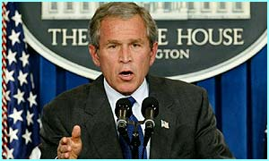 President George W Bush speaks at the White House