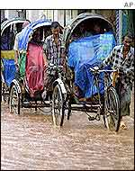 Rickshaws struggle against floods in Dhaka, Bangladesh