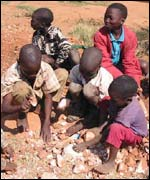 Children breaking rocks