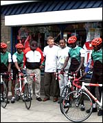 Kenyan cycling team outside shop that lent them bikes
