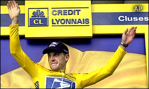 Overall leader Lance Armstrong of Austin, Texas, waves from the podium