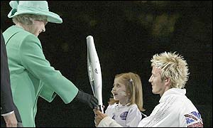 England football captain David Beckham and Kirsty Howard hand the Jubilee Baton to the Queen