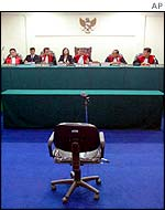 An empty defendant's chair in the Jakarta court hearing Tommy Suharto's case