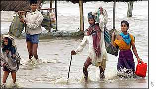 Assam villagers abandon flooded home