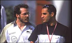 Jacques Villeneuve and Juan Pablo Montoya chat in the Formula One paddock