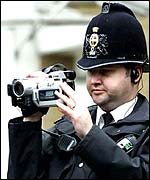 Police man using a video camera