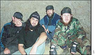 Khattab (second left) and Achimez Gochiyayev (second right)