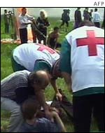 Rescue workers attending an injured man