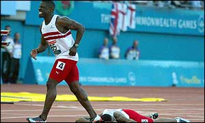 Dwain Chambers (top) and Mark Lewis-Francis crash out of the 100m final