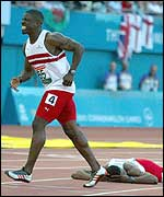 The stricken Dwain Chambers and Mark lewis-Francis